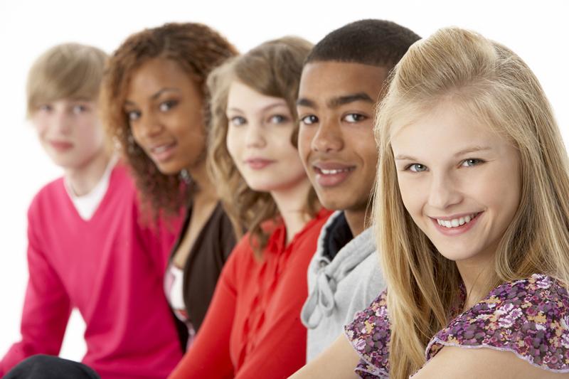 Studio Portrait Of Five Teenage Friends Standing In Line